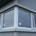 Clonmacash Rd Portadown White fixed  corner window with top opening sashes to both ends.
