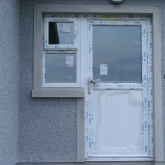 Clonmacash Rd Portadown White pvc door with T&G half panel.