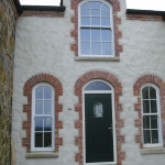 Loughbrickland Rd Banbridge Composite green T&G door with TG45 glass on cream frame and arch sliding sash windows.