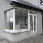 Drumanphy Rd Portadown Cream pvc french doors with fanlight and fixed corner window.