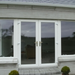 Cusheny Rd Portadown Pvc whitefoil french doors and fixed sidelights.