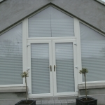 Cusheny Rd Portadown Pvc whitefoil french doors and fixed angle windows.